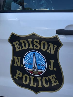 An Edison police officer has been stripped of his gun and badge following a domestic incident Monday in New Brunswick.
