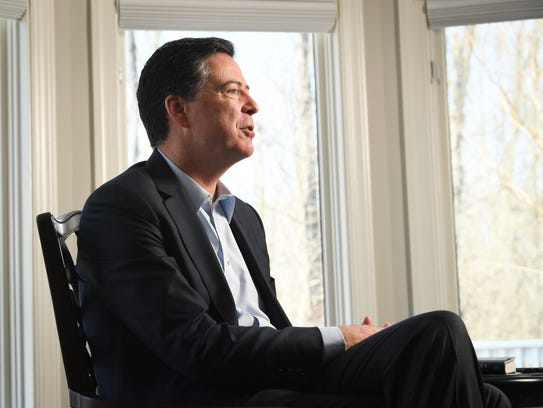 Former FBI director James Comey sits for an interview