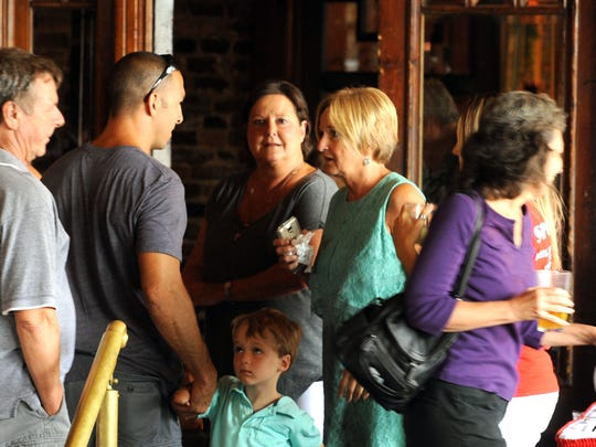 Tara Blackwell's mom, Patsy Pate, visits with friends Saturday during Tarafest at Seville Quarter. All proceeds went to the Tara Blackwell Medical Fund.