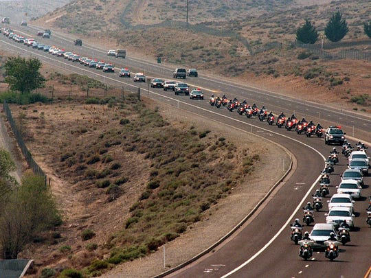 A miles-long funeral procession for slain Reno policeman