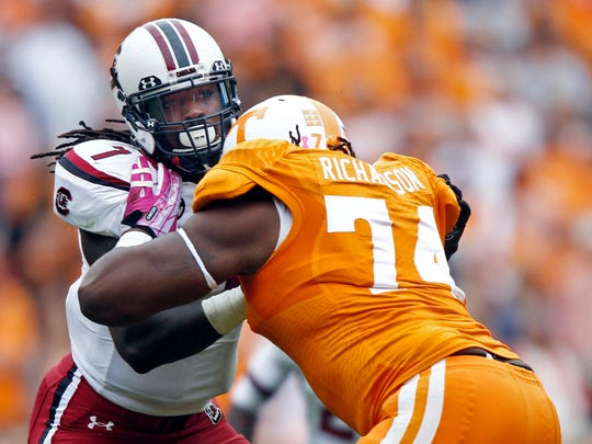 ADVANCE FOR WEEKEND EDITIONS, MAY 3-4 - FILE - In this Oct. 19, 2013, file photo, South Carolina defensive end Jadeveon Clowney (7) rushes against Tennessee offensive linesman Antonio Richardson (74) during the second quarter of an NCAA college football game in Knoxville, Tenn. Clowney finished last season with 11 1/2 tackles for loss and three sacks after getting 23 1/2 and 13 in 2012. He is a top prospect in the upcoming NFL draft. (AP Photo/Wade Payne, File)