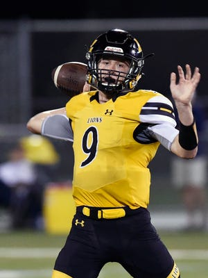 Red Lion quarterback Sam Emig prepares to pass against Chambersburg in the first half of a high school football game Friday, Sept. 16, 2016, at Red Lion.