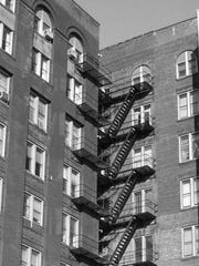 A rear fire escape as seen from Exchange Boulevard of the Union Trust Building (19 W. Main St.).