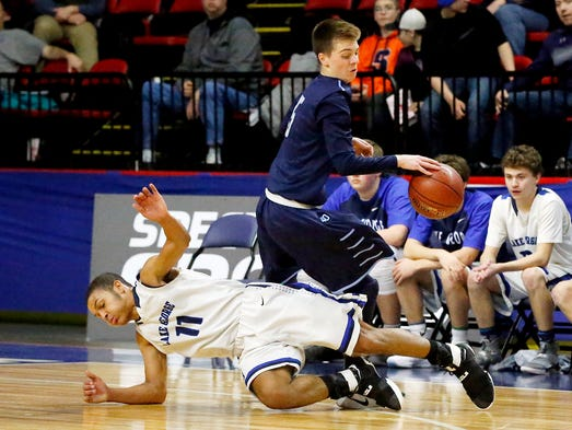 Moravia's Carter Flick is knocked off balance by Lake