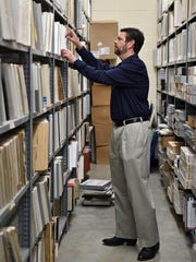 Malaco Music Group President Tommy Couch Jr. looks through shelves of records in the vault.
