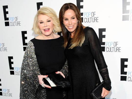 """This April 30, 2012 file photo shows comedian and TV host Joan Rivers from the show """"Fashion Police"""" and her daughter Melissa Rivers at an E! Network upfront event in New York. Rivers, the raucous, acid-tongued comedian who crashed the male-dominated realm of late-night talk shows and turned Hollywood red carpets into danger zones for badly dressed celebrities,  died Thursday, Sept. 4, 2014. She was 81. Rivers was hospitalized Aug. 28, after going into cardiac arrest at a doctor's office."""