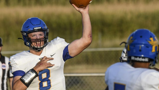 Hutchinson High School quarterback Myles Thompson throws a screen pass to Noah Khokhar Friday against Garden City at Buffalo Stadium. The Salthawks won the non-conference battle 21-20 to move to an overall record of 2-0.
