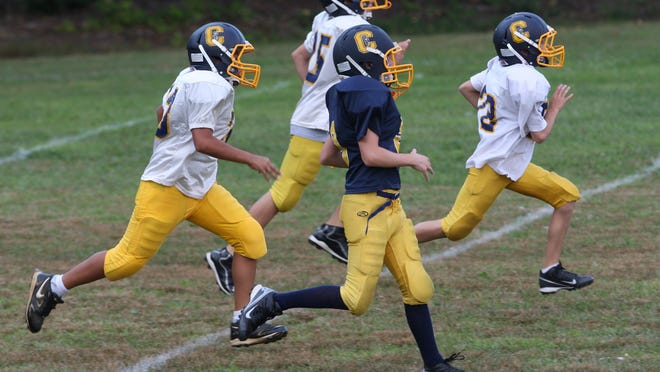 Pop Warner athletes practice in this 2012 file photo.