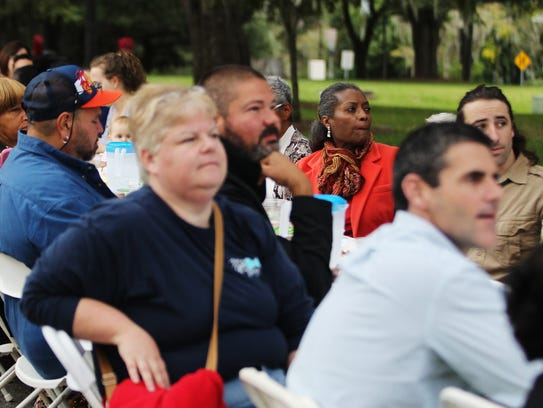 Residents listen to speakers during a Longest Table