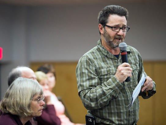 Binghamton resident Scott Lauffer speaks during a public