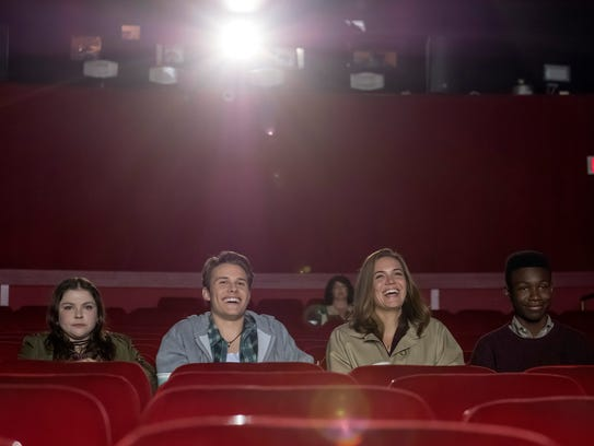 Rebecca (Mandy Moore), second from right, who split
