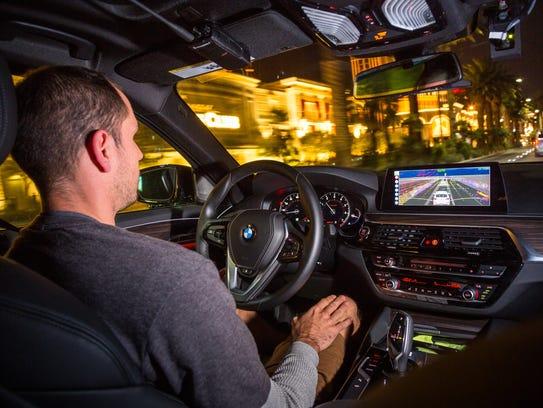 The APTIV vehicle with autonomous technology drives on the Las Vegas strip Friday, Dec. 1, 2017.