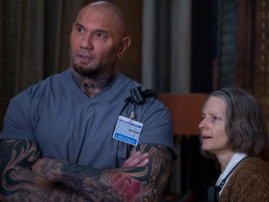 "Dave Bautista and Jodie Foster star in ""Hotel Artemis."""