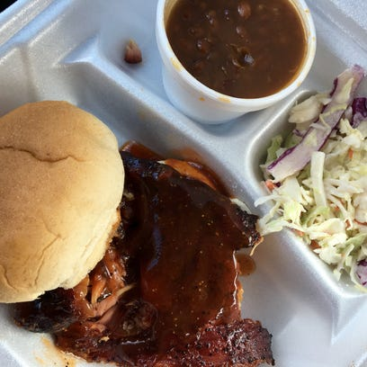 A rib sandwich with slaw and beans from Smokin R's