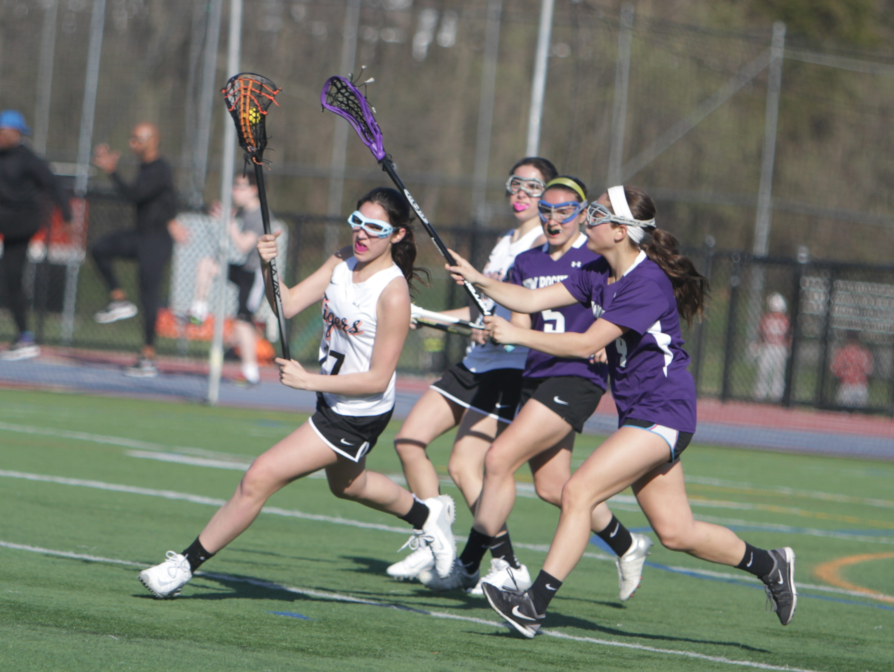 Action during a Section 1 girls lacrosse game between New Rochelle and White Plains at White Plains High School on Wednesday, April 13th, 2016. White Plains won 11-6.