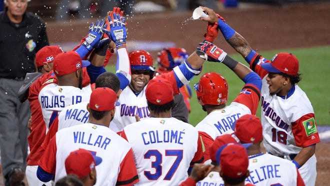 The defending WBC champion Dominican Republic celebrating its victory the other night.