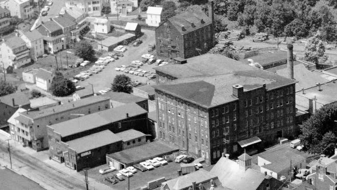 This bird's-eye scene from Glen Rock shows a lot. The tall building served as a carriage maker and then a furniture factory. It's now chopped down to three stories. The low building behind the smokestack at about 3 o'clock is today known as Ruins Hall or Ruins Park. The Glen Rock Mill Inn, the mill that formed the nucleus of early Glen Rock, is in the foreground beside the railroad tracks. All this clustering around the railroad points to its importance as a means to convey goods created in Glen Rock to market.