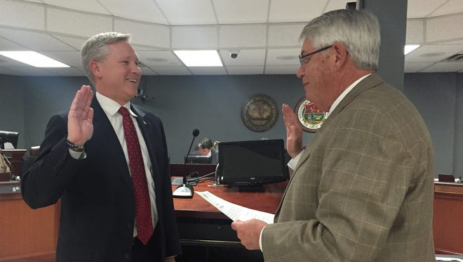 Williamson County Mayor Rogers Anderson, right, swears in District 7 interim County Commissioner Bobby Hullett, a former school board member.