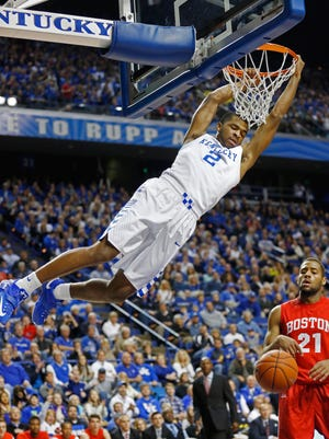 Kentucky Wildcats guard Aaron Harrison dunks the ball against Boston University during the first half Friday night at Rupp Arena.