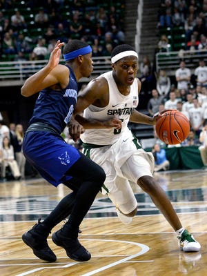 Spartans guard Cassius Winston drives the lane during MSU's opening exhibition game Thursday, Oct. 27, 2016 at the Breslin Center in East Lansing.