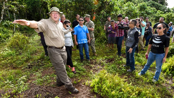 Archaeologist Ronnie Rogers, left, describes a site where a Chamorro earth oven complex was discovered, during a tour of the Naval Computer and Telecommunications Site at Finegayan, Dededo on Oct. 5, 2017.