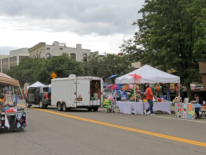 Vendors are busy setting up for Elmira's 150th anniversary party that starts at 5 p.m. Friday on East Water Street.