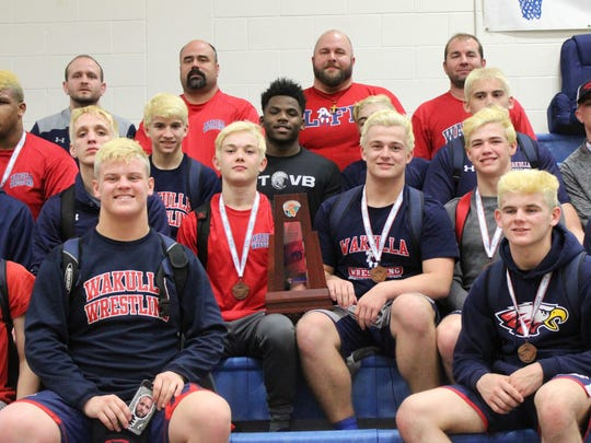 Wakulla's wrestling team celebrates a Region 1-1A runner-up
