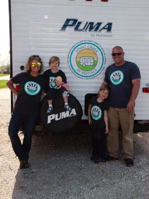 Caitlin Brotz-McNitt and her family outside one of Point Creek's campers. Brotz-McNitt started the business three years ago and will be expanding to Sheboygan this summer.