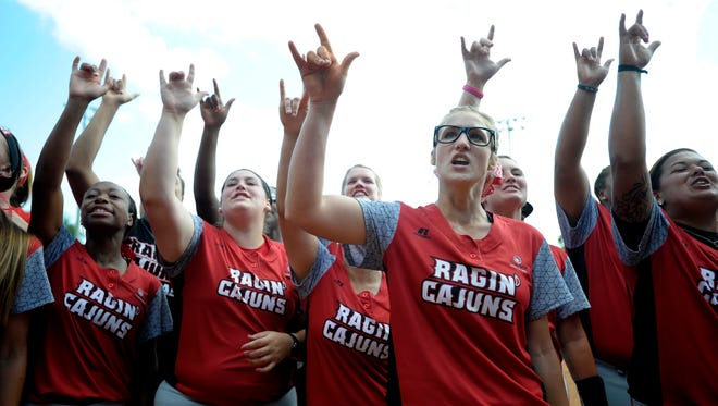 The UL softball team leads a chant with fans following their 7-1 victory over Arizona in an NCAA softball Super Regional game at Lamson Park. UL defeated Arizona to win the Super Regional and advance to the NCAA Women's College World Series in Oklahoma City.