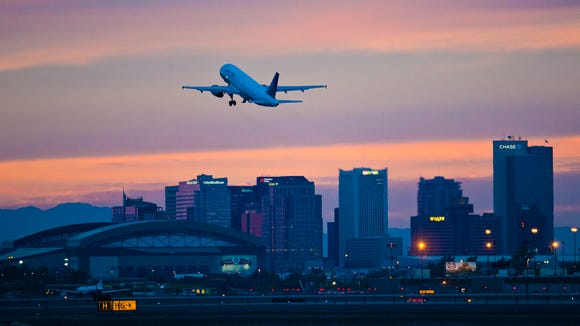 A United Airlines plane takes off from Phoenix Sky Harbor Airport November 18, 2013.