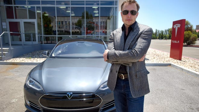 Elon Musk CEO of Tesla, with a new Model S  car outside the customer delivery area at the Tesla factory in Fremont, Calif.