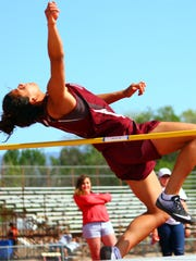 Tularosa senior Cassie Vickery attempts to clear the bar during the high jump event Friday afternoon.