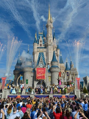 Fireworks punctuate the grand opening celebration at the Cinderella Castle for the New Fantasyland attraction at the Walt Disney World Resort's Magic Kingdom theme park in Lake Buena Vista, Fla., in 2012.