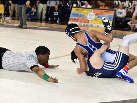 Escalera goes for the pin during his match.
