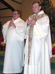 The Rev. William Scully, O.F.M., right, with The Rev. Richard Husted O.F.M. during service at Saint Mary's Church in Pompton Lakes. Father Bill died at the age of 78 after a long life of service with the Catholic church.
