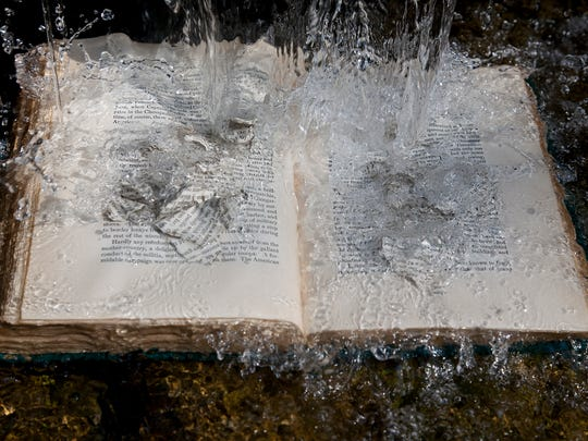 """""""The Book"""" includes pictures of sculptures Julius Friedman created and then photographed and the work of 24 writers whose poetry and prose speak their thoughts and feelings about books."""