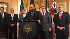Ohio Speaker Cliff Rosenberger, center, announces a
