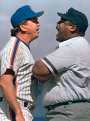 FILE - In this Aug. 31, 1988, file photo, New York Mets manager Davey Johnson and umpire Eric Gregg argue during the Mets' baseball game against the San Diego Padres in New York. Johnson is one of only four managers to win 300 games with the team. (AP Photo/Ray Stubblebine)