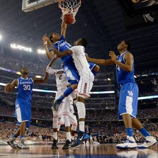 Apr 7, 2014; Arlington, TX, USA; Kentucky Wildcats guard/forward James Young (1) dunks over Connecticut Huskies center Amida Brimah (35) in the second half during the championship game of the Final Four in the 2014 NCAA Mens Division I Championship tournament at AT&T Stadium. Mandatory Credit: Robert Deutsch-USA TODAY Sports