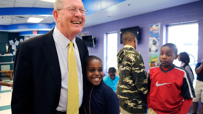 U.S. Sen. Lamar Alexander gets a hug from Jujuan Carter Scruggs while Alexander tours the Boys and Girls Clubs on 16th Avenue North on Sept. 24.
