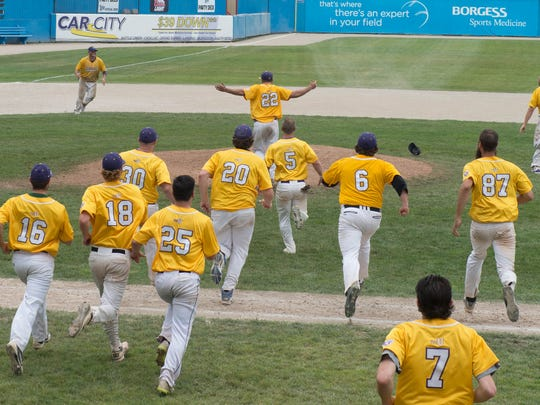 Battistoni Diesel team members run on the field after winning the National Amateur Baseball Federation World Series in 2015.