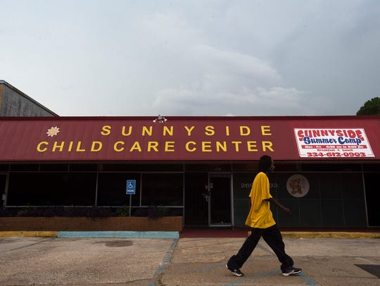 A man walks passed Sunny Side Child Care Center at