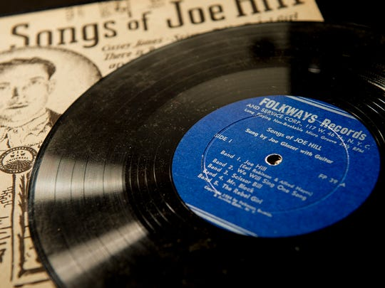 """In this Aug. 21, 2015, photo, the album """"The Songs of Joe Hill"""" by folksinger Joe Glazer, released in 1954 on Folkways Records is photographed in Salt Lake City. Lionized in a song sung by Pete Seeger and Bruce Springsteen, labor activist and songwriter Joe Hill is revered by many as a hero and martyr. To others, Hill was a murderer who gunned down a Salt Lake City grocer and his son and got what he deserved when he was executed by firing squad in 1915."""