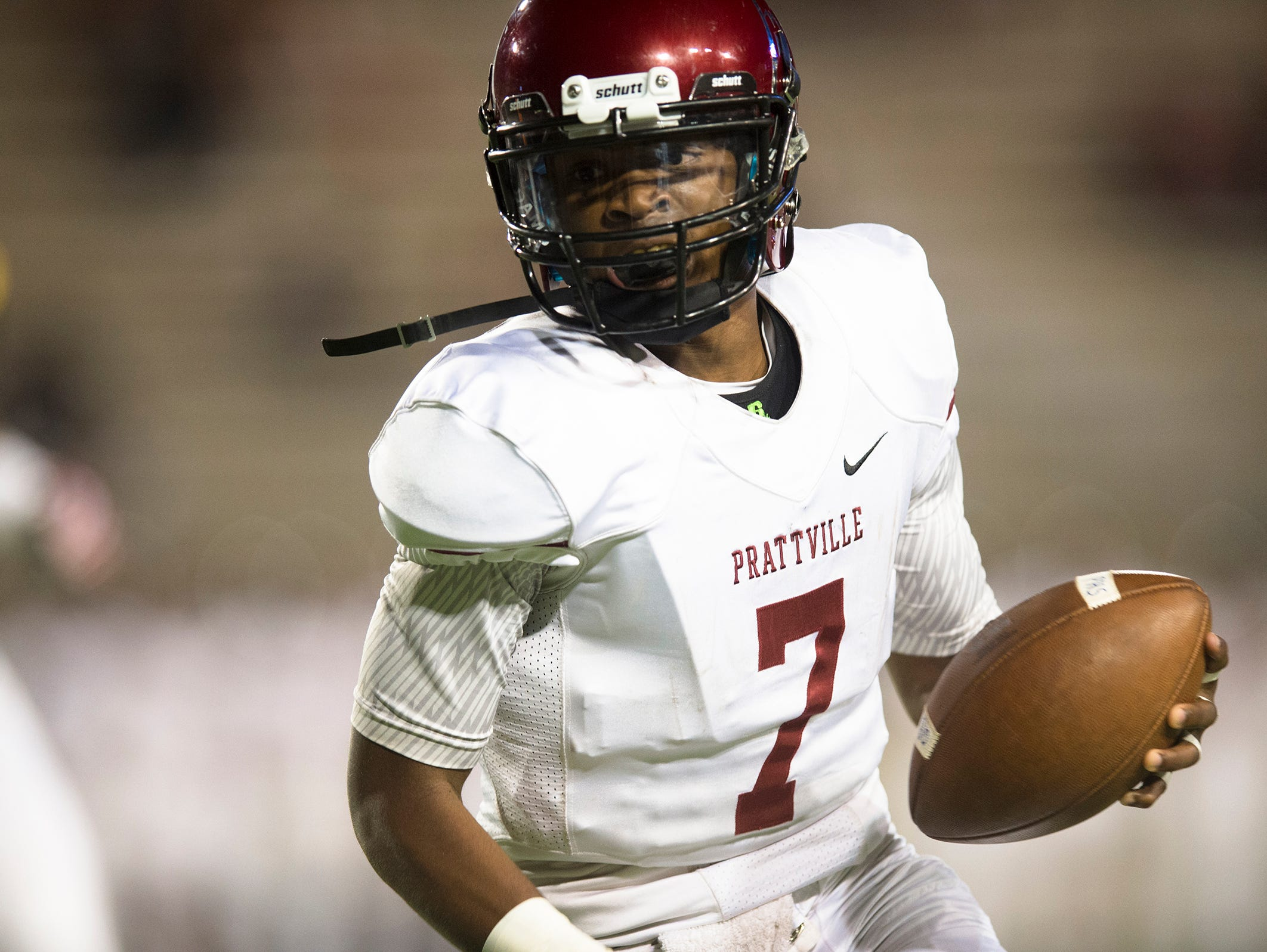 Prattville's Josh Moore (7) runs around the end during the AHSAA football game on Friday, Sept. 25, 2015, at Cramton Bowl in Montgomery, Ala.