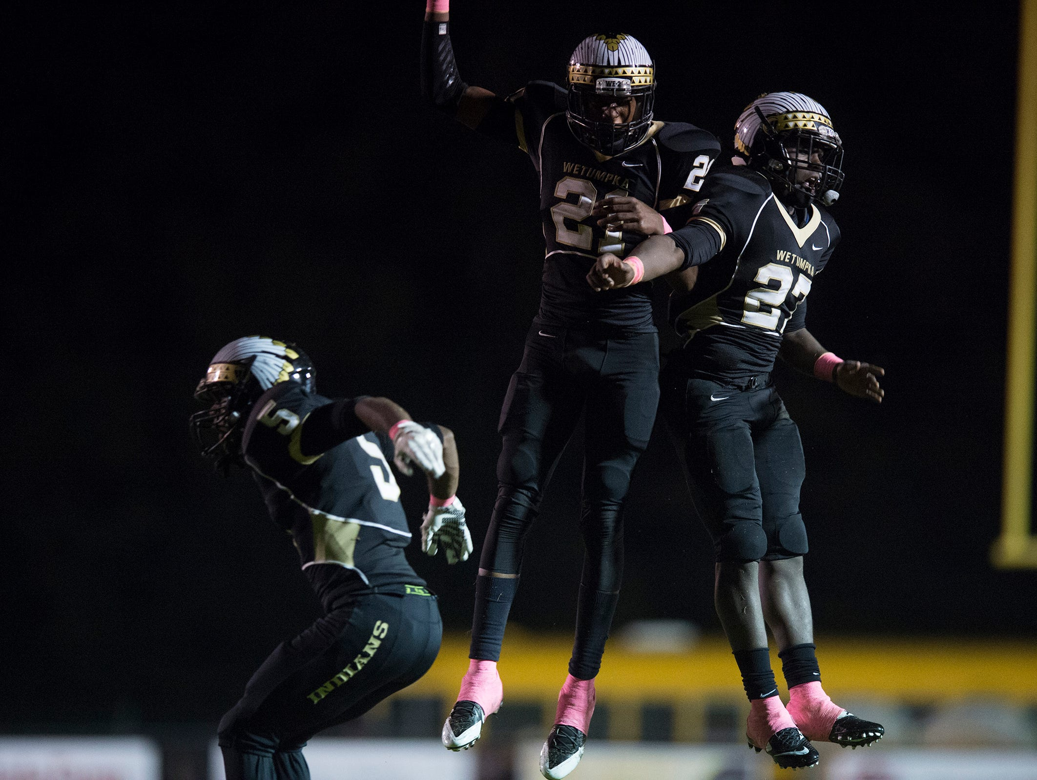 Wetumpka's Mack Caldwell (22) and Kavoskey Smoke celebrate after Stanhope failed to convert on a two point conversion with 11 seconds left in the game leaving Wetumpka with a 14-13 lead on Friday, Oct. 2, 2015, in Wetumpka, Ala. Wetumpka defeated Stanhope-Elmore 14-13 after a failed two point conversion.