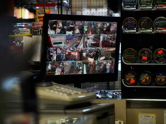 Footage from 16 cameras is displayed on a monitor next to the cash register at West Market Convenience Store in York.