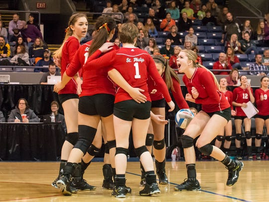 St. Philip players celebrates after a point against Leland in the Class D state finals at Kellogg Arena