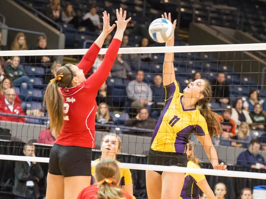 St. Philip's Anna Lehouiller goes for the block during Saturdays state volleyball finals against Leland.