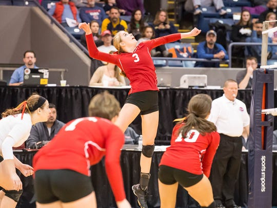 St. Philip's Abby Mckinzie goes for the kill shot during Saturday's state volleyball finals against Leland.