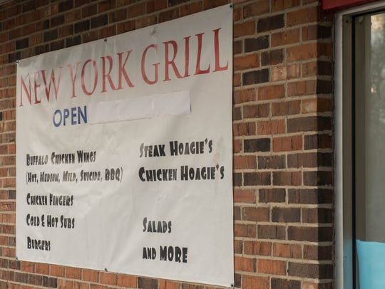 Outside menu sign for New York Grill.